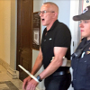 GMHC's Eric Sawyer getting arrested at Senator McConnell's office
