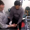A technician tests a patient's abductor pollicis brevis muscle to help make a diagnosis for carpal tunnel syndrome.