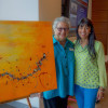"Rosette Becker and Lakshmi Nayak, MD, with Becker's ""One Day at a Time"" (2014)"