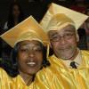 Two graduates embrace.