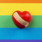 rainbow flag and heart with bandaid